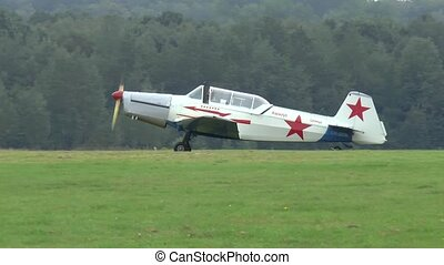 Zlin Z-236M single engine airplane prepares for takeoff from a grass airfield in Poland.