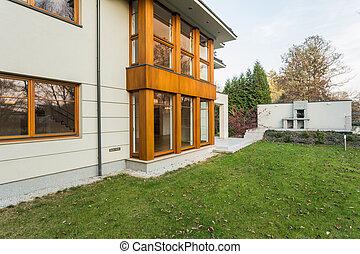 Single-family house exterior with beauty garden