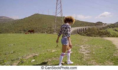 Single female in shorts walking along dirt road - Beautiful...