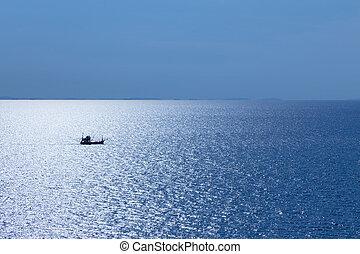 Single fishing boat in the ocean