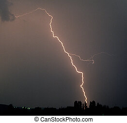 flash of lightning during a thunderstorm - single flash of...