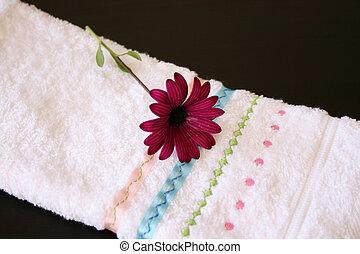 Single Flower - Single Purple Daisy flower on a hand towel