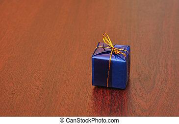 single gift box on wood background