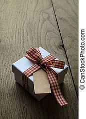 Single Gift Box with Gingham Ribbon and Blank Label on Wood