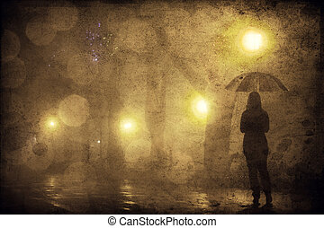 Single girl with umbrella at night alley. Photo with noise.