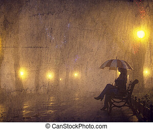Single girl with umbrella sitting at the bench at night.