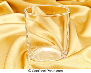 single glass at golden background