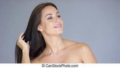 Single gorgeous woman with hand behind neck