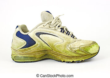 Single grass stained old sneaker - A single grass stained ...