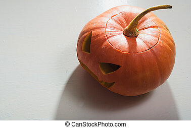 Single Halloween pumpkin. Scary Jack o lantern face,