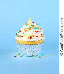 Single iced cupcake with colorful sprinkles