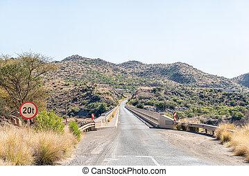 Single lane road bridge over Orange River below Vanderkloof Dam