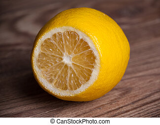 single lemon on wooden background