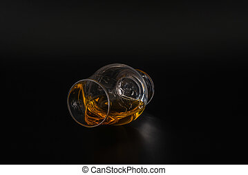 single malt tasting glass, single malt whisky in a glass, black  background