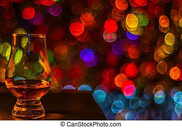 single malt tasting glass, single malt whisky in a glass, bokeh background