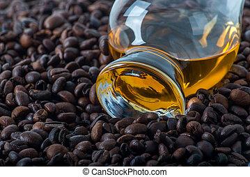 Single malt tasting glass, single malt whisky in a glass, coffee background