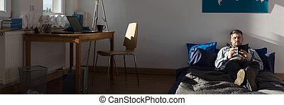 Single man in his apartment