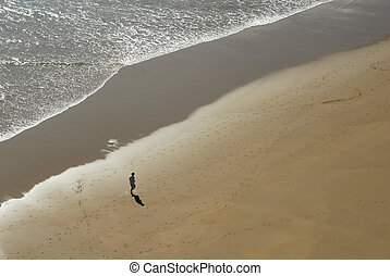 single man jogging on the beach