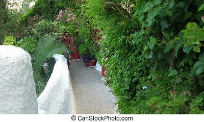 """single man walking narrow streets of plaka, athens, greece,..."