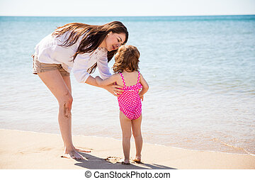 Portrait of a beautiful young single mother spending the day at the beach with her daughter