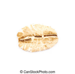 Single oat flake isolated over the white background
