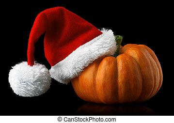 Single orange pumpkin with Christmas Santa hat