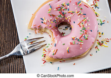 Single Pink Donut on a plate