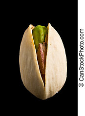 Single pistachio nut isolated on black
