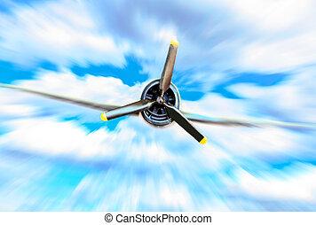 Single propeller fighter plane against blue sky in motion blur