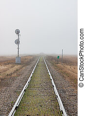 Single Railroad Track Receding into Fog