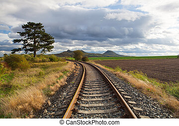 Single railway track in Rana, Czech Republic - Single...