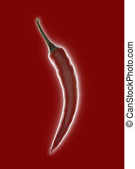 Single red chilli pepper with backlight glow on a red background