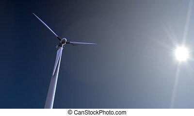 Single rotating wind turbine against blue sky and blazing...