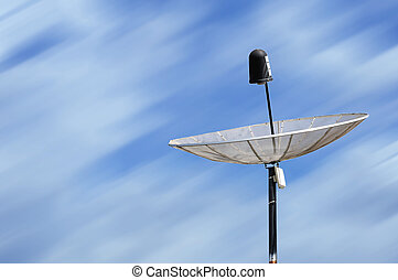 Single satellite dish with blur background.