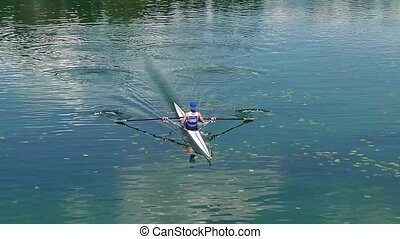 Single scull rowing competitor paddles, full hd, slow motion...