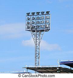 Single spot-light pole with blue sky in stadium
