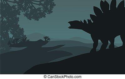 Single stegosaurus silhouette in hills