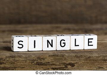 Single - The word single written in cubes on wooden...