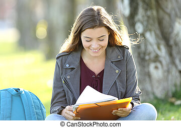 Single student girl studying reading notes