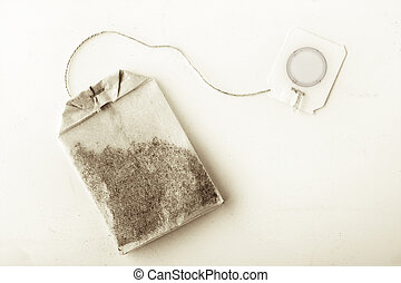 Single tea bag on the white background top view