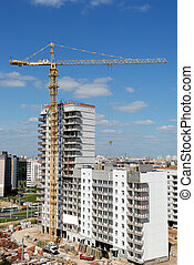 Single tower column crane loader lifting a load at construction site