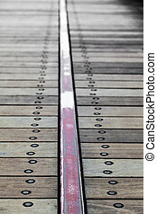 Metal single track line between wooden panels