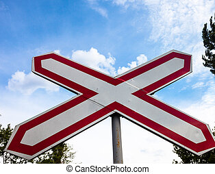 Single track railway crossing sign in Ukraine. Close up.