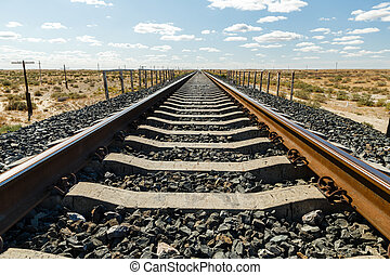 single-track railway line, railway track in the steppe of Kazakhstan