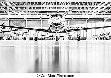 Single turboprop aircraft in hangar. - Single turboprop...