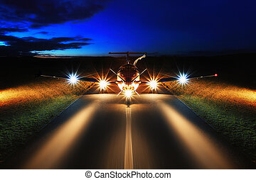Single turboprop aircraft on the groun, night