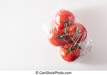 single use plastic packaging issue. tomatoes vegetables in plastic bag
