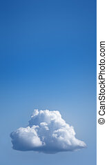 Single fluffy white cloud in blue sky with a lot of copy space