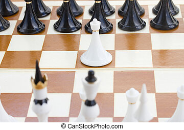 white pawn in front of black chess