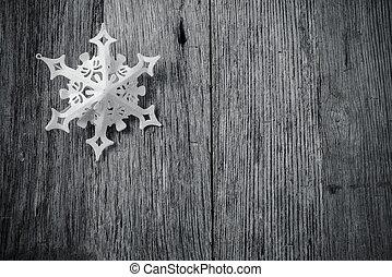Single White Snowflake on Rustic Wood Background